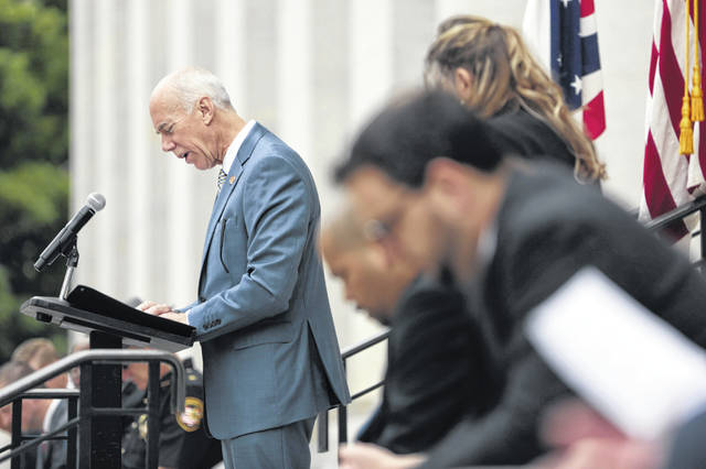 State Rep. Tim Ginter, R-Salem, leads a prayer during a June event at the Statehouse.