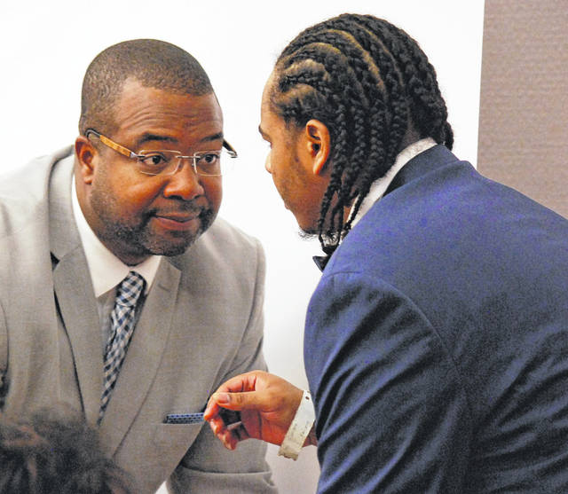 Defense Attorney Anthony Vannoy confers with his client, Chaz Jackson, during the opening day of Jackson's murder trial Tuesday in Allen County Common Pleas Court.