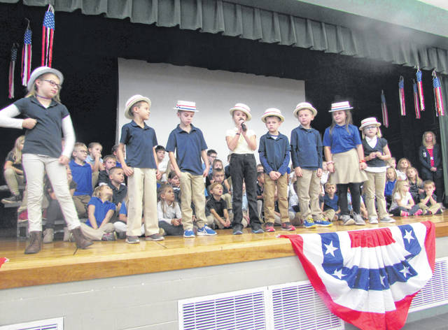 Students at SS. Peter & Paul Catholic School participated in a program to honor veterans Friday at the school.