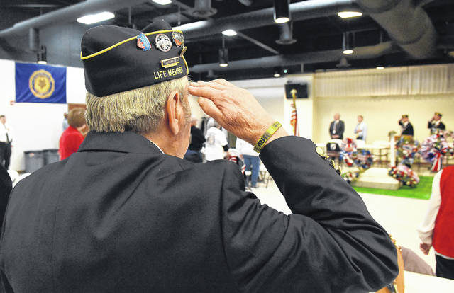 Rod Keller salutes during the playing of taps Monday at American Legion Post 96's Veterans Day Ceremony. Keller is a life member of the Disabled American Veterans.