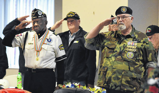 Raleigh Batty, left, Paul Swick and Tom Routson salute during the playing of taps at American Legion Post 96's Veterans Day Ceremony on Monday.