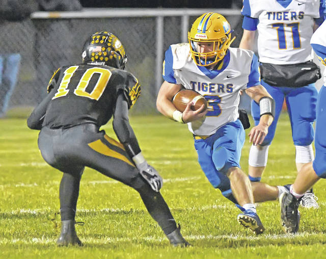 Waynesfield-Goshen's Joel Rickle looks to get around Hardin Northern's Frank McCoy during Friday night's game in Dola.