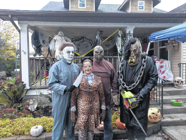 This family dresses up to pass out candy for Halloween at the scariest house in Waynesfield. Pictured are, from left, Lana Hall, Jay Carter, Elise Taylor, Brian Carter and Steve Shepherd.