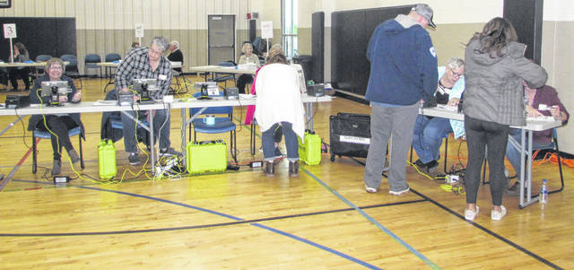 Voters sign in to cast their votes Tuesday morning at Putnam County YMCA in Ottawa.