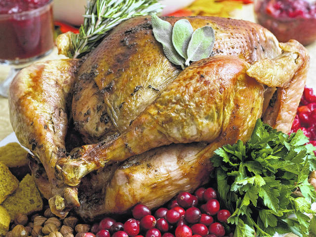 Food safety experts say raw turkeys shouldn't be rinsed, since that can spread harmful bacteria. Cooking should kill any germs. But bacteria can still spread in other ways, so washing and sanitizing hands and surfaces is still important. (AP Photo/Larry Crowe, File)