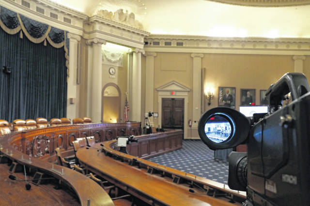 A television camera shows the hearing room where the House will begin public impeachment inquiry hearings Wednesday. (AP Photo/Jacquelyn Martin)