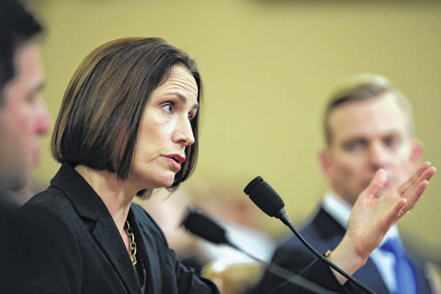 Former White House national security aide Fiona Hill, and David Holmes, a U.S. diplomat in Ukraine, right, testify before the House Intelligence Committee on Capitol Hill in Washington, Thursday, Nov. 21, 2019, during a public impeachment hearing of President Donald Trump's efforts to tie U.S. aid for Ukraine to investigations of his political opponents.