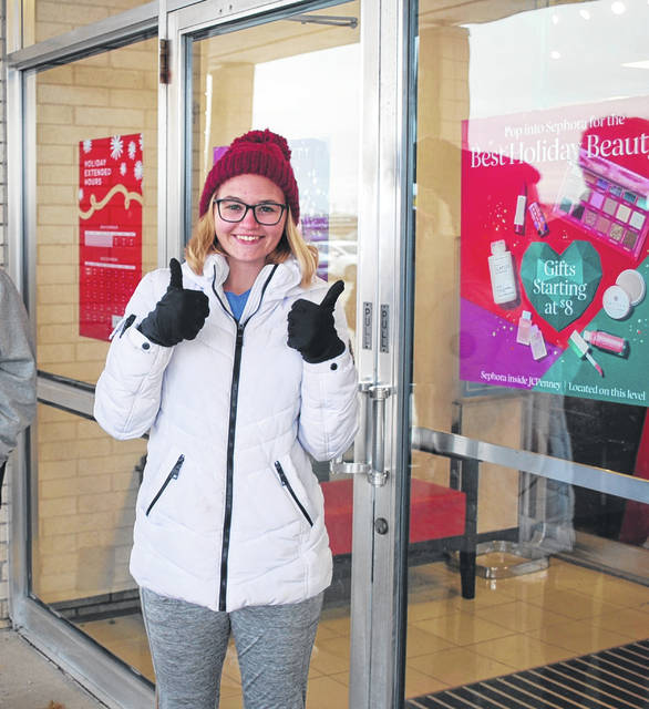 Erica King, of Lima, stood outside the JCPenney store in Lima for three hours Thursday as the first in line for holiday shopping deals and the possibility of free cash, courtesy of the retail giant.