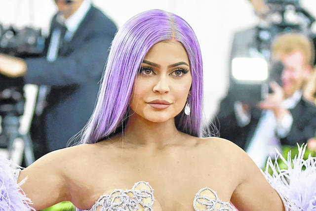 FILE - In this May 6, 2019, file photo, Kylie Jenner attends The Metropolitan Museum of Art's Costume Institute benefit gala in New York. Reality TV star Kylie Jenner is selling a stake of her beauty brand to Coty, the owner of CoverGirl makeup. Coty Inc. will pay $600 million for a 51% stake in Kylie Cosmetics, valuing it at about $1.2 billion. Coty says it plans to launch more products under the Kylie brand and sell them in more countries around the world.