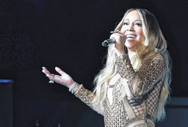 """In early celebration of her favorite holiday, Mariah Carey released a new video for her seasonal classic """"All I Want for Christmas Is You."""" AP Photo/Kamran Jebreili)"""