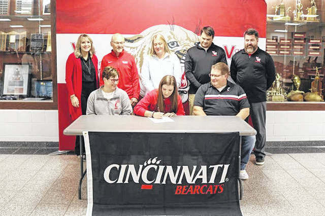 Kirsten Clay was joined by her parents and coaches when she signed her letter of intent to compete in track and field at the University of Cincinnati.