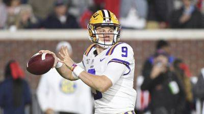 Quarterback Joe Burrow and the LSU Tigers remain atop the latest College Football Playoff rankings. (AP photo)