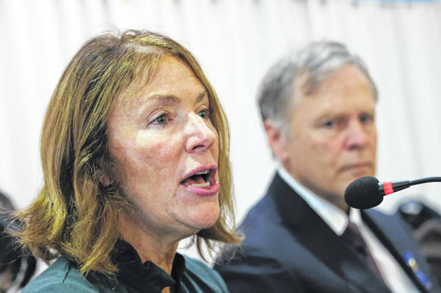 Cindy Warmbier, left, speaks as his husband Fred listens on, about their son Otto Warmbier who died after being released by North Korea in 2017 during a press conference in Seoul, South Korea, Friday, Nov. 22, 2019. The Warmbiers say they are committed to finding and shutting down illicit North Korean business assets around the world in efforts to hold its government accountable for widespread human rights abuses.