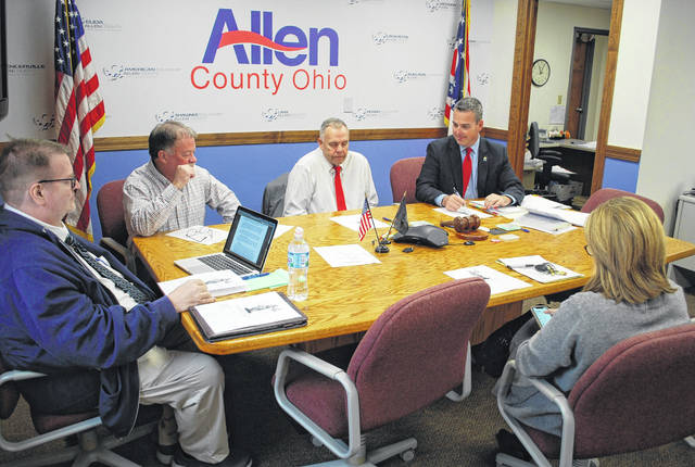 Longtime defense attorney Steve Chamberlain, left, who oversees the public defender program in Allen County, met with the Allen County commissioners Thursday to discuss the possibility of a full-time staff of public defenders in the county.
