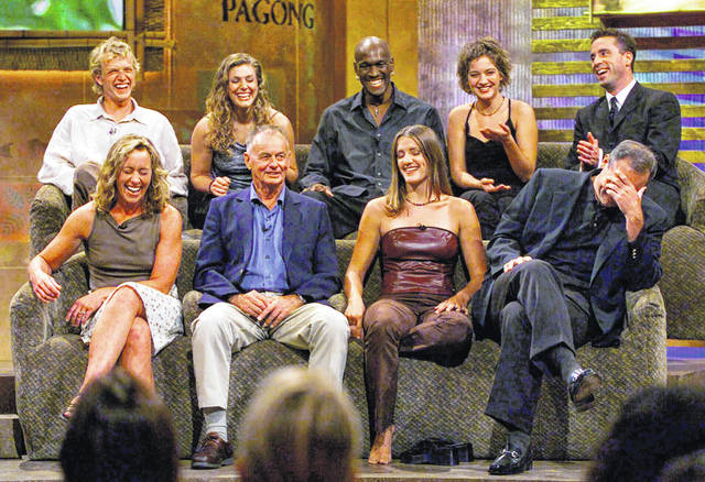 """In this Aug. 23, 2000, file photo, a group of """"Survivor"""" contestants, break into laughter during a live town hall meeting at CBS Studios in Hollywood in Los Angeles. Survivors are, from left, bottom row, Susan Hawk, Rudy Boesch, Kelly Wiglesworth and Richard Hatch, covering his face, top row, Greg Buis, Jenna Lewis, Gervase Peterson, Colleen Haskell and Sean Kenniff. Boesch, a retired tough-as-nails Navy SEAL and fan favorite on the inaugural season of """"Survivor,"""" died Friday, Nov. 1, 2019, after a long battle with Alzheimer's disease. He was 91. (AP Photo/Kevork Djansezian, File)"""