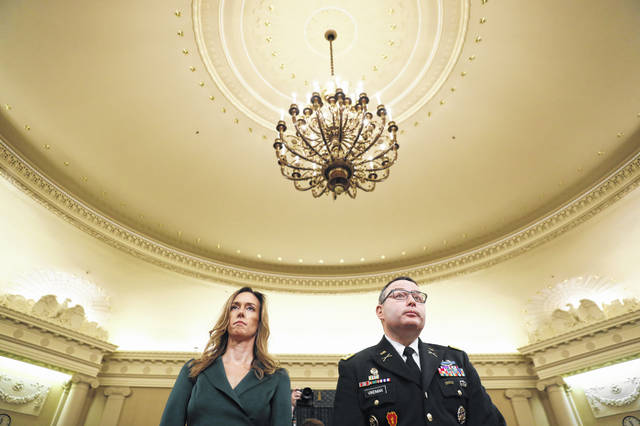 Jennifer Williams, an aide to Vice President Mike Pence, and National Security Council aide Lt. Col. Alexander Vindman stand as they take a break in hearing before the House Intelligence Committee on Capitol Hill in Washington, Tuesday, Nov. 19, 2019.