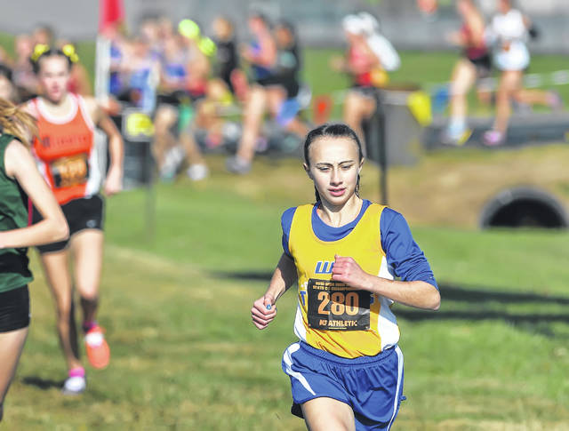Waynesfield-Goshen's Taylor Spencer competes in the Division III girls race at Saturday's state championships at National Trail Raceway in Hebron.