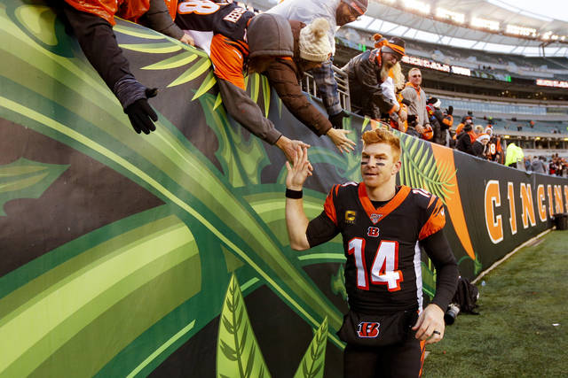 Cincinnati Bengals quarterback Andy Dalton (14) celebrates with fans after an NFL football game against the New York Jets, Sunday, Dec. 1, 2019, in Cincinnati. (AP Photo/Frank Victores)