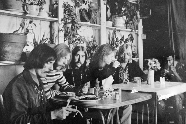 """FILE - This undated file photo, shows members of the Allman Brothers Band, from left, Dickey Betts, Duane Allman, Berry Oakley, Butch Trucks, Gregg Allman and Jai Johanny """"Jaimoe"""" Johanson, eating at the H&H Restaurant in downtown Macon, Ga. Capricorn Sound Studios, the Macon, Ga., music studio that fused blues, country and other sounds into Southern rock is being reborn. The historic Studio A is reopening this month, after years of work by Mercer University and other supporters to restore and equip it with state-of-the-art technology. The studio helped propel the Allman Brothers Band and other groups to stardom in the 1970s. (The Macon Telegraph via AP, File)"""