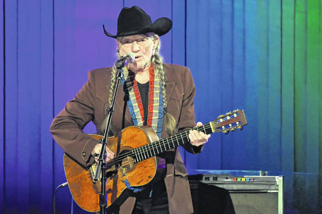 Willie Nelson performs Nov. 13 in Nashville, Tenn. Nelson may have given up smoking, but he hasn't stopped using marijuana. His spokeswoman, Elaine Shock, told The Associated Press in an email Wednesday that Nelson hasn't given up cannabis, and she points out there are different ways to consume it.