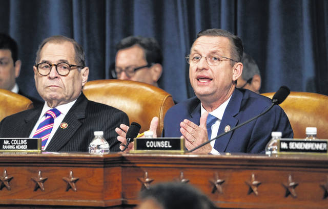 Rep. Doug Collins, R-Ga., the ranking member of the House Judiciary Committee, sits beside Chairman Jerrold Nadler, D-N.Y., while making his opening statement during a hearing on the constitutional grounds for the impeachment of President Donald Trump on Wednesday in Washington, D.C.