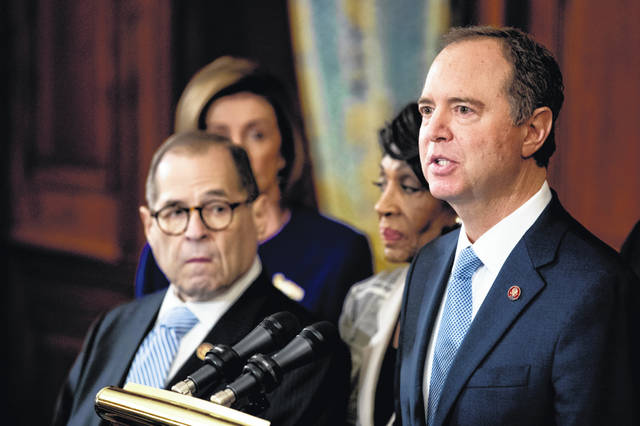 Rep. Adam Schiff, D-Calif., Chairman of the House Intelligence Committee, right, speaks Tuesday with, from left, Chairman of the House Judiciary Committee Jerrold Nadler, D-N.Y., House Speaker Nancy Pelosi and Chairwoman of the House Financial Services Committee Maxine Waters, D-Calif., second from right, during a news conference to unveil articles of impeachment against President Donald Trump, claiming abuse of power and obstruction of Congress.