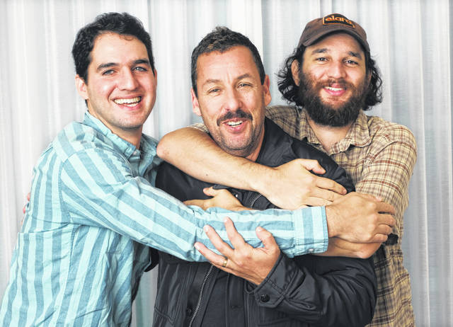 """Adam Sandler, center, star of the film """"Uncut Gems,"""" poses for a portrait with co-directors Benny Safdie, left, and his brother Josh at the St. Regis Hotel during the Toronto International Film Festival in Toronto."""