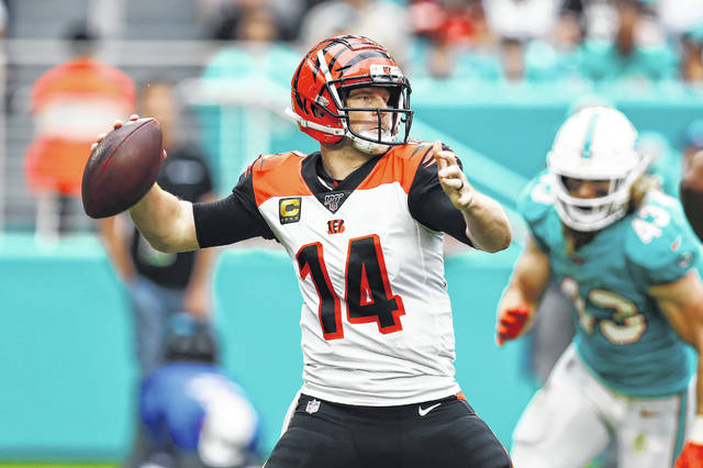 Cincinnati Bengals quarterback Andy Dalton (14) looks to pass, during the second half at an NFL football game against the Miami Dolphins, Sunday, Dec. 22, 2019, in Miami Gardens, Fla. (AP Photo/Brynn Anderson)