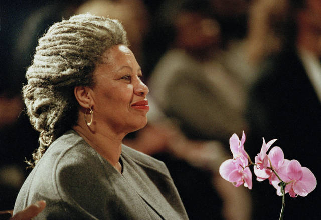 FILE - In this April 5, 1994, file photo, Toni Morrison as she holds an orchid at the Cathedral of St. John the Divine in New York. Publisher Alfred A. Knopf says Morrison died Aug. 5, 2019, at Montefiore Medical Center in New York. She was 88. (AP Photo/Kathy Willens, File)