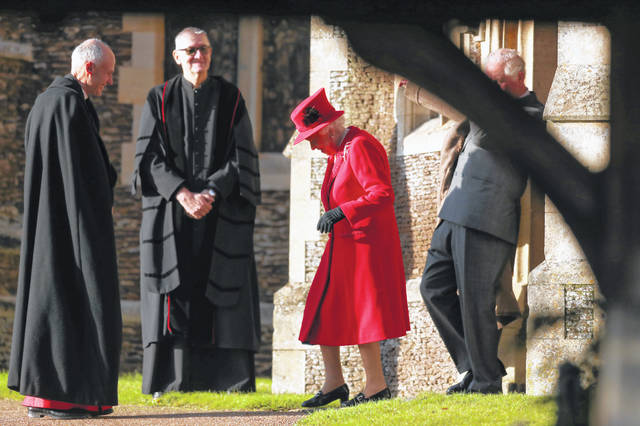 Britain's Queen Elizabeth II arrives to attend the Christmas Day service at St Mary Magdalene Church in Sandringham in Norfolk, England, on Wednesday.