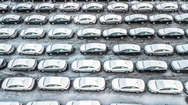 Hundreds of Chevrolet Cruze cars sit in a parking lot at General Motors' assembly plant in Lordstown on Dec. 5, 2018. The long-struggling Rust Belt community of Youngstown, which was stung by the loss of the massive General Motors Lordstown plant this year, wants to become a research and production hub for electric vehicles.