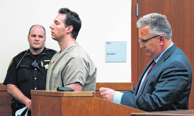 Former critical care doctor William Husel, center, pleads not guilty in June to murder charges while appearing with defense attorney Richard Blake, right, in Franklin County Court in Columbus. Nusel, facing 25 counts of murder for his role in the deaths of hospital patients, said in a defamation lawsuit filed against the hospital system he worked for that he did nothing wrong and did not deviate from hospital policy in providing end-of-life care.