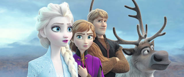 """This image released by Disney shows Elsa, voiced by Idina Menzel, from left, Anna, voiced by Kristen Bell, Kristoff, voiced by Jonathan Groff and Sven in a scene from the animated film, """"Frozen 2."""""""