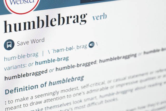 """The word humblebrag is displayed on a computer screen. Merriam-Webster sums up the humble-brag nicely: """"to make a seemingly modest, self-critical, or casual statement or reference that is meant to draw attention to one's admirable or impressive qualities or achievement."""" The dictionary titans say the term has been around since 2002."""