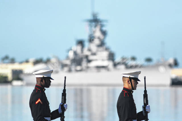 U.S. Marines stand in front of the USS Missouri during a ceremony to mark the 78th anniversary of the Japanese attack on Pearl Harbor, Saturday, Dec. 7, 2019 at Pearl Harbor, Hawaii. Survivors and members of the public gathered in Pearl Harbor to remember those killed when Japanese planes bombed the Hawaii naval base 78 years ago and launched the U.S. into World War II. About a dozen survivors of the attack attended the annual ceremony, the youngest of whom are now in their late 90s.