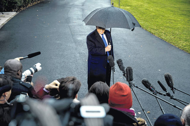 President Donald Trump speaks to members of the media Dec. 2 before boarding Marine One on the south lawn of the White House. The U.S. House's impeachment of Trump was selected the top story of 2019 by a panel of AP subscribers.