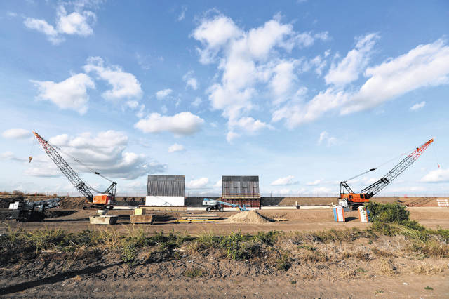FILE - In this Nov. 7, 2019, file photo the first panels of levee border wall are seen at a construction site along the U.S.-Mexico border in Donna, Texas. Three years into Donald Trump's presidency, the U.S. government is finally ramping up its efforts to seize the private land it needs to build a border wall in South Texas.