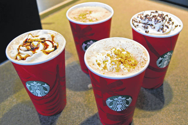 "FILE - This Monday, Nov. 24, 2014 file photo shows four holiday Starbucks coffee drinks, clockwise from left, the Gingerbread Latte, the Eggnog Latte, the Peppermint Mocha, and the new Chestnut Praline Latte, at a store in Seattle. On Friday, Dec. 20, 2019, The Associated Press reported on stories circulating online incorrectly asserting that the manager of a Starbucks in North Carolina informed his employees they would be fired on the spot for saying ""Merry Christmas"" to customers. Company spokesman Reggie Borges countered, ""Our baristas are offered the autonomy to choose how to greet each person."""