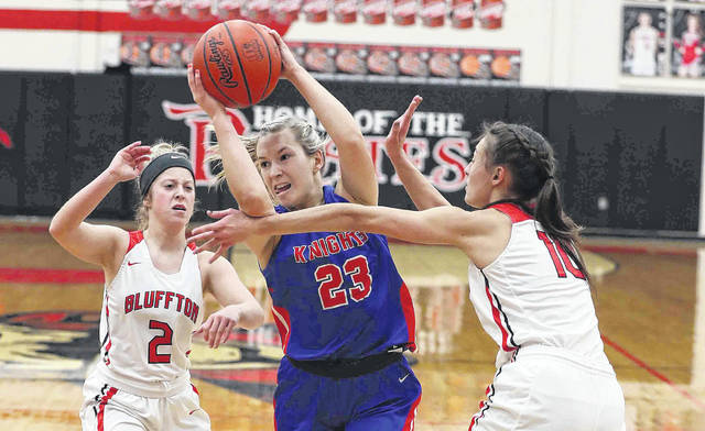 Bluffton's Brinkley Garmatter (2) and Kylie Stackhouse defend Crestview's Olivia Cunningham during Thursday night's game at Bluffton.