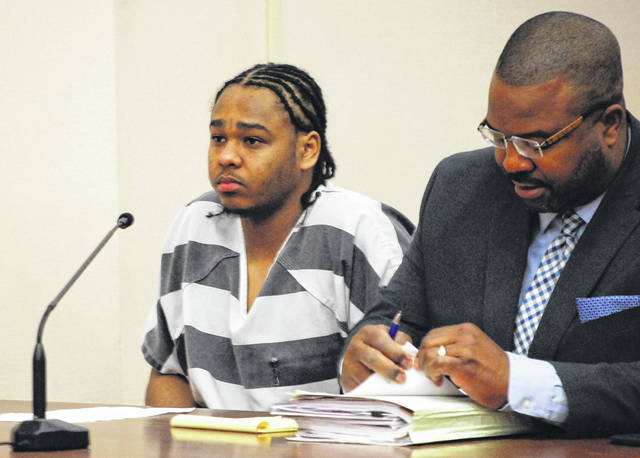 Chaz Jackson, 24, was sentenced to 14 years in prison Monday following his conviction by a jury last month of involuntary manslaughter in the 2016 shooting death of Wapakoneta resident Ryan VanBuskirk. Jackson is pictured with his attorney, Anthony Vannoy.