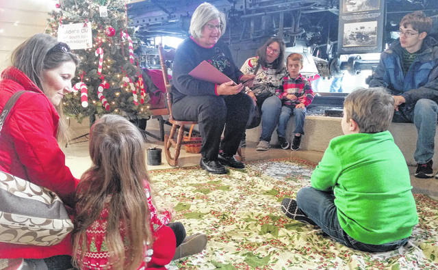 """As part of the Christmas Tree Festival at the Allen County Museum, """"The Polar Express"""" was read by Ann Miller."""