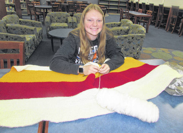 Paige Meyer, Ottawa-Glandorf High School sophomore, works on crocheting a blanket Monday at the high school's library.