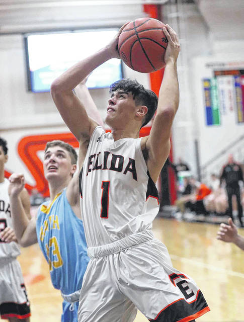 Elida's Dylan Buetner puts up a shot against Bath's Jonah Wauben during Friday night's game at the Elida Fieldhouse.