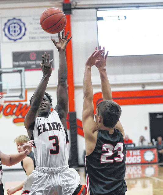 Elida's Ja'Quan Moore puts up a shot against Spencerville's Keegan Goecke during Friday night's game at the Elida Fieldhouse.