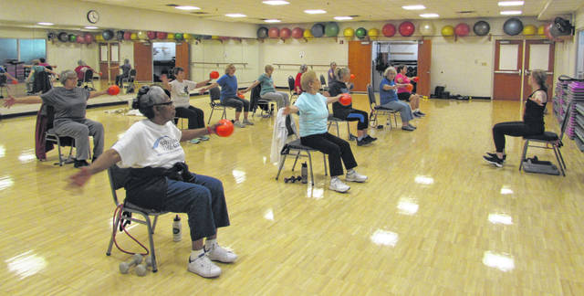 A Silver Sneakers class partipates in a workout this week at the Lima Family YMCA.