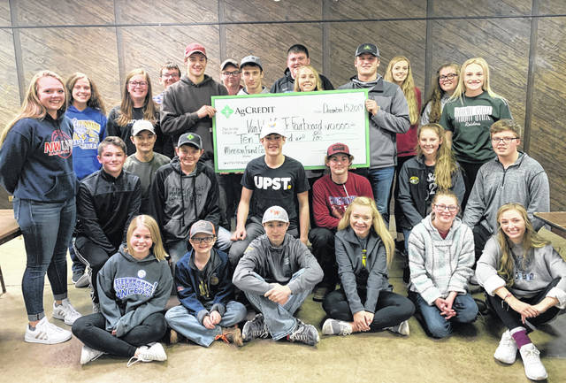 Pictured is the Van Wert County Junior Fair Board accepting their $10,000 grant check that will be used to make repairs to the new arena.