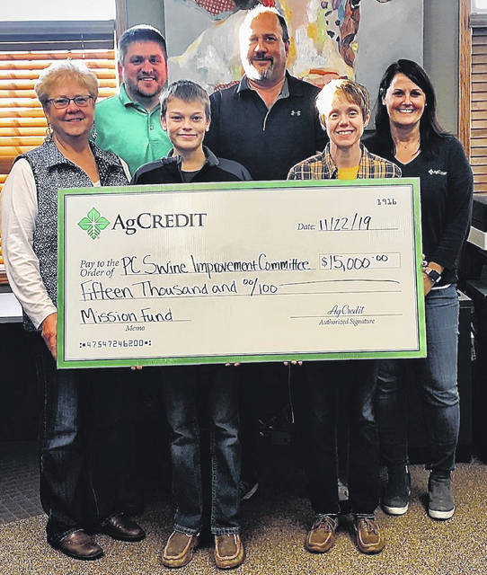 Putnam County Swine Improvement Committe pictured left to right is Cynthy Kleman, committee; Zac Maag, AgCredit; Bryce Hoffman, swine exhibitor; Ken Kottenbrock, committee; Melissa Meyer, committee; Heather Brickner, AgCredit; during the check presentation in November.