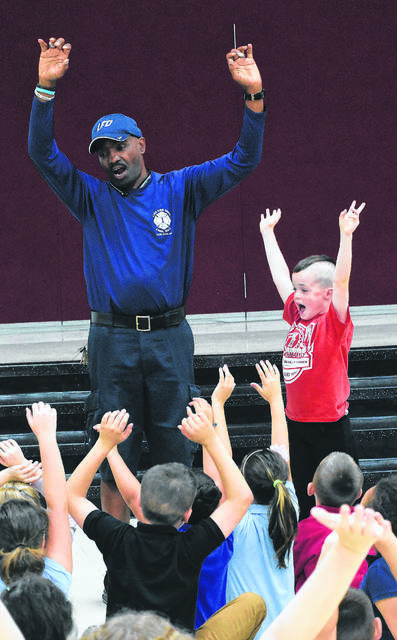 Chris Jackson, of the Lima Fire Department, instructs Connor Conley and fellow third-grade students on fire safety during a fire prevention program on at Independence Elementary School in 2017. Jackson is retiring from the department after 33 years of service with the city. Craig J. Orosz filw phoro | The Lima News