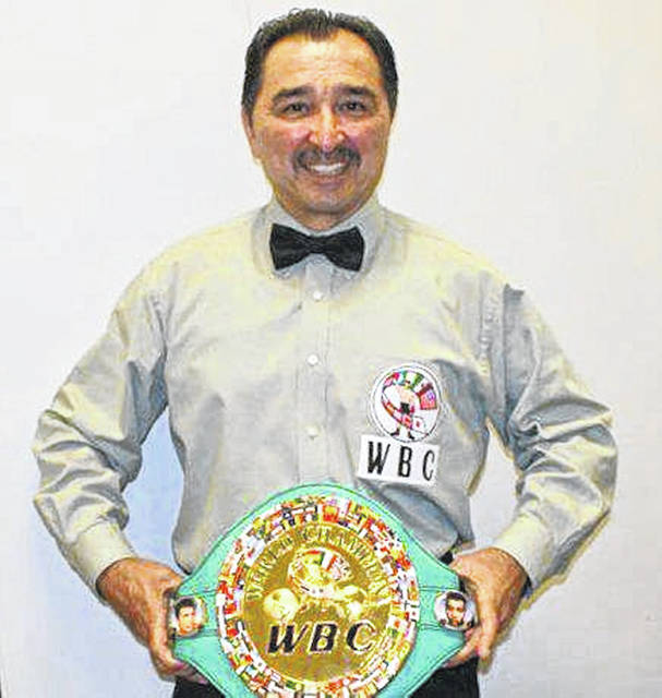 Frank Garza with WBC championship belt.