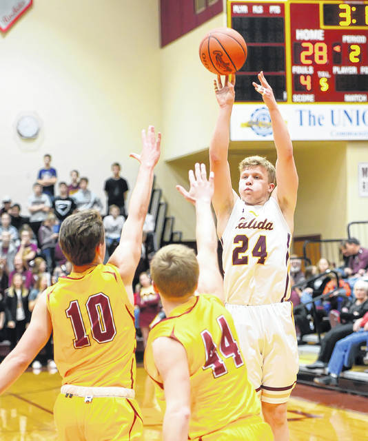Kalida's Evan Roebke shoots against New Bremen's Reece Busse, left, and Ryan Paul during Monday's game at Kalida High School.